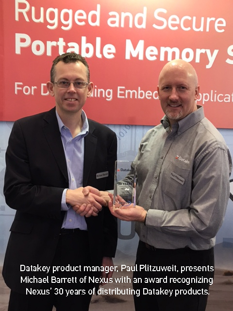 Datakey product manager, Paul Plitzuweit, presents Michael Barrett of Nexus with an award recognizing Nexus' 30 years of distributing Datakey products.