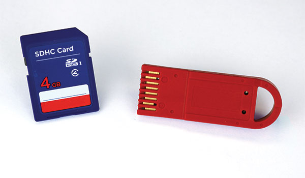 SD card (left) next to a Datakey DFX RUGGEDrive memory token (right).